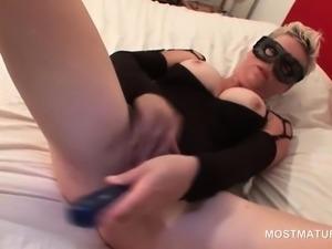 Masked blonde mature fucks herself with dildo