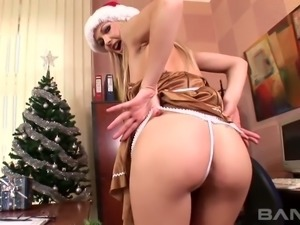 Horny office slut Dee Cee is masturbating on Christmas day