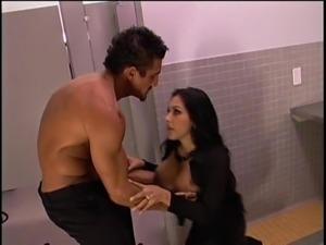 Big tits of a dark-haired babe shaking while fucking in the toilet