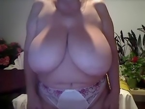 Milf with sexy undies and huge tits lets them free