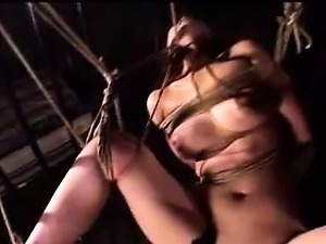 Oriental bondage fetishist getting suspended and covered in