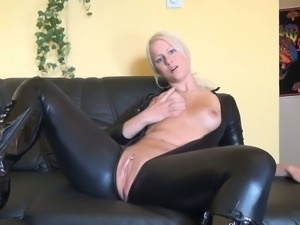 Gorgeous emotional busty blonde babe in spandex costume plays with toy
