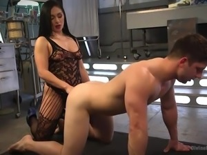 His cock is dripping precum, because she is ramming his tight asshole with a...