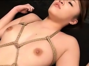 Submissive Oriental girl with a fabulous ass enjoys a rough