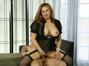 Chubby redhead slut Friday rides dude's hard dick on the couch
