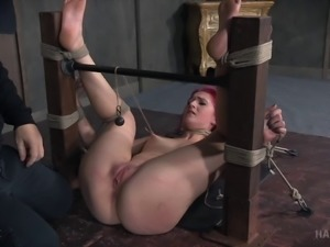 Woman with pink hair has fun while being treated like a sex slave