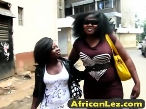 Two busty and horny African lesbians satisfying each other