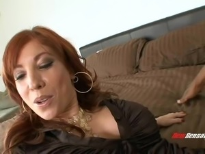 Charming redhead milf loves riding big black cocks hardcore
