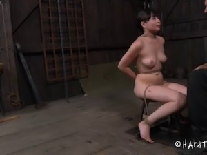 Asian bondage slave tied with ropes in BDSM porn shoot