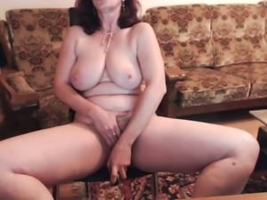 Big boobed woman toying her vagina intensively