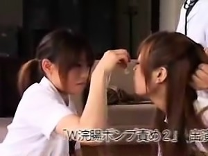 Two dazzling Oriental lesbians take turns licking each othe