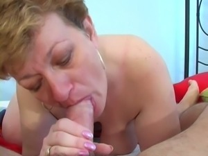 Short haired busty housewife giving head after shower