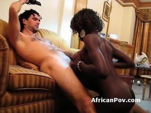 Busty African babe takes white boner in pussy