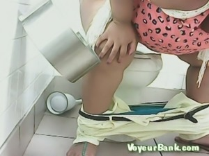 Black mature BBW woman filmed in the public toilet room