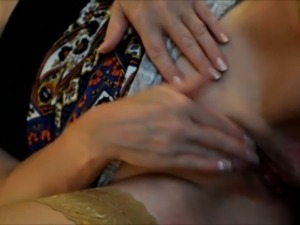 Ardent amateur housewife in beige stockings was teasing her wet pussy