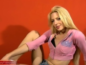 Ravishing blonde tranny removes her clothes before jerking her fat rod
