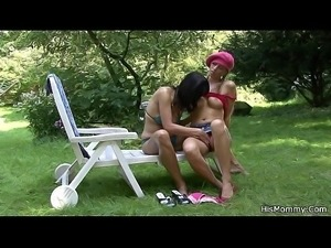 Busty milf lesbian and teen outdoor action
