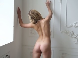 Skinny and young blonde skank strips and shows her petite booty