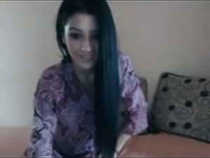 Desirable Arab girl dancing teasingly on webcam