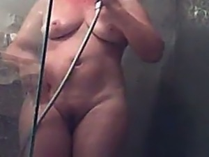 Kinky spy cam vid of chubby housewife taking a shower and drying her butt