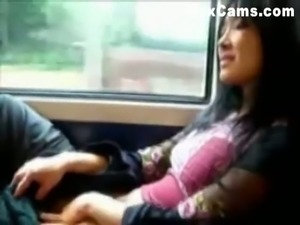 This horny Asian chick has no problem masturbating on public transport