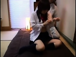 Delightful Japanese teen gets her tight snatch fingered by