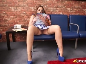 Juicy redhead white woman on the couch spreads her legs to tease with pussy