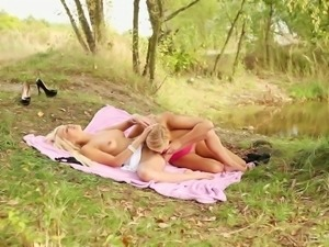 Two hot young blonde girls outdoors make out and get into softcore lesbian...