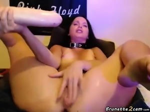 Brunette milf masturbates with a big dildo