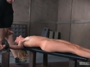 Blonde white lady on the table nude and bound for BDSM threesome