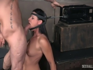 Brunette lean beautiful babe fixed and shackled for BDSM facefuck session