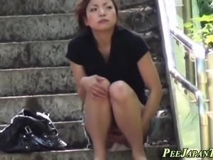 Japanese ho pees outdoors