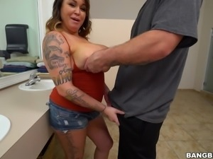 Sizzling hot milf Brandy Talore saunters into the bathroom wearing a wee red...