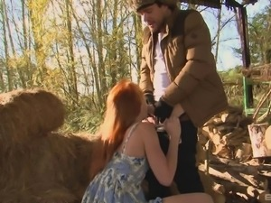 Ginger-haired Sabrina Jay having fun with her partner's dick in a barn