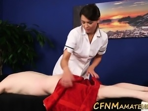 Clothed masseuse blows