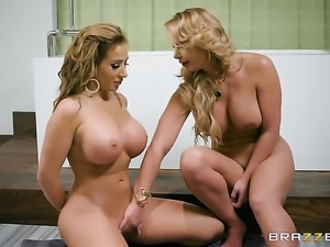 Blonde Richelle Ryan and Phoenix Marie strips before they