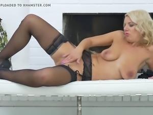 Busty Milf masturbating in stockings