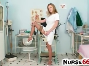 Olga Barz a naughty nurse takes 2 dildos at once