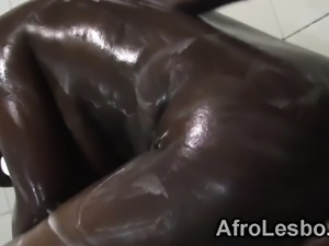African lesbians playing under shower