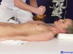 petite blonde has an intense orgasm in the massage room