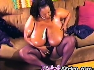 Fat African Chick Oiling Her Plump Body On Couch