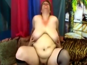 Mature blonde BBW masturbates with a dildo then gets fucked by younger