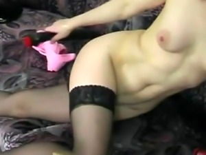 A slutty blonde babe takes off her clothes and fucks herself with a di