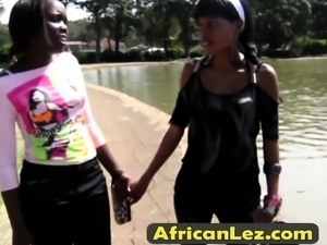 Nasty African lesbians getting wild with a big strap-on