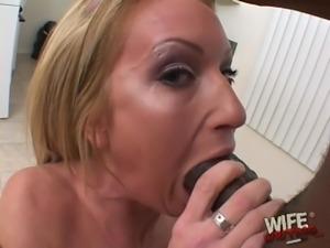 Blonde floozy Cameron enjoys receiving a black shaft in her mouth