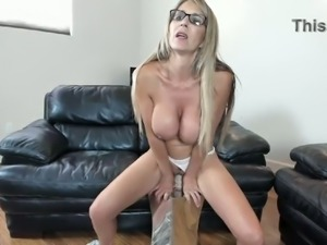 Busty MILF is riding her dildo like it's the real thing