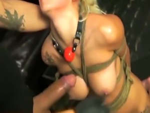 Blonde babe in bondage deep throats a thick cock while being strangled