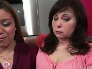 Fresh brunette and mature slut undress to tease wet pussies of each other