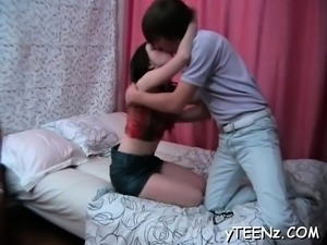 Gorgeous horny teen gets down on knees and gives oral sex