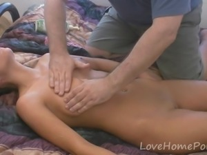 Teen with medium tits receives a massage